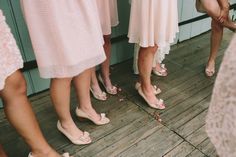 bridesmaids in blush bridesmaids dresses and pretty bow topped shoes | photo by @Lauren Davison Fair