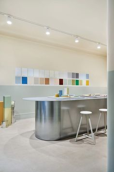 """Finnish plastic-free paint company Cover Story has opened its first shop: a """"paint studio"""" fitted out by interior designer Linda Bergroth to offer customers multiple ways to explore colour."""