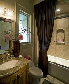 Small Bathroom: Arched Ceilings-the arched ceiling above the shower adds a lot of depth to the room, the glass doors work well, and the curtain helps square the bathroom a little so it doesn't look so square.  The recessed shelf in the shower works well, also.