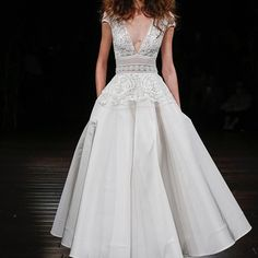 Beaded peplum bodice and silk faille tea-length skirt on the MARSAILLE gown #fall2017 #nyfwbridal #naeemkhanbridal #bridalfashionweek #bridalstyle #bridalrunway #wedding #love #romance #bride