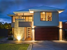 Photo of a concrete house exterior from the realestate.com.au Home Ideas Facades image galleries - House Facade photo 184595. Browse hundreds of concrete facade designs from Australian homes on Home Ideas.