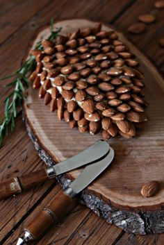 Pine Cone Shaped Holiday Cheese Ball. 4 ingredients and 15 minutes are all you need!