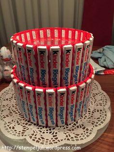 Kinderriegel an Dosen angeklebt Ü-Eier-Torte