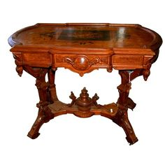Antique American Victorian Renaissance Revival Inlaid Center Table Executed In Walnut    c.1880