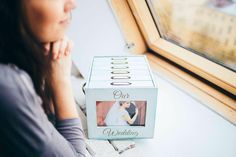 Turquoise and white wooden photo box with 6 photo albums and front photo frame…