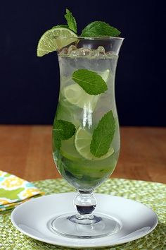 Mojitos:  10-15 small fresh mint leaves, plus a sprig for garnish  1 lime, sliced into thin rounds  1 lime, juiced (approx. 1 oz. or 2 tablespoons of juice)  1 oz. (2 tablespoons) simple sugar syrup  2 oz. (4 tablespoons) light rum  ice, cubes or crushed  3 oz. (6 tablespoons) club soda