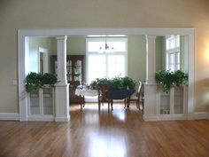seperating a living room and dining room | Built-in bookcases and columns create a dining room