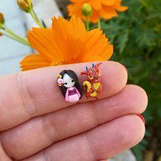 Mulan and Mushu stud earrings inspired by the Disney