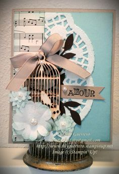 Mother's Day, Shabby Chic, Vintage inspired handmade card. It all started with the lovely birdcage, just love it! Also used a retired Stampin' Up! stamp from the Artistic Etchings set. Includes, Crumb Cake, Coastal Cabana, Early Espresso cardstock, Modern Medley DSP, Taffeta ribbon in crumb cake. Tools used: Pansy punch, Boho Blossoms punch, Little Leaves Sizzlits and the Big Shot. For more information please visit my blog. Thank you