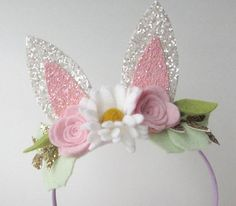 Hop hop hop these bunny ears are perfect for Easter! Bunny ears are made of glitter canvas accented by a floral felt bouquet. This headband comes on satin lined metal headband and backed with felt for comfort. Bunny ears are Bunny Ears Headband, Diy Headband, Diy Hair Bows, Diy Bow, Metal Headbands, Baby Headbands, Felt Flowers, Fabric Flowers, Felt Crafts