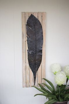 $64.00 hand hammered, metal feather on recycled slatted wood frame