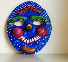 http://www.thatartistwoman.org/2008/10/how-to-make-paper-mache-mask-art.html