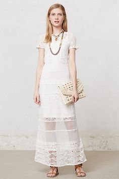 Perfect for an outdoor summer wedding this dress from Anthropologie is full length with a sheer section at the bottom. It's relaxed, feminine and 100% vegan!