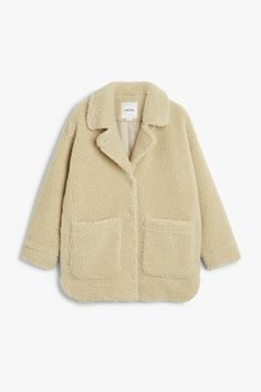 Buy this: Monki Shearling coat - loose enough to wear over all your layers