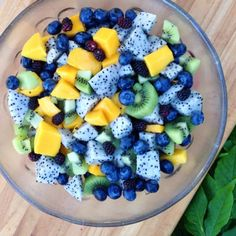 This mornings rainbow breakfast fruitbowl. Mangos, kiwis, blueberries, dragon fruit, & blackberries!