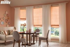 Pair rollar shades with drapes for a practical, graceful look!