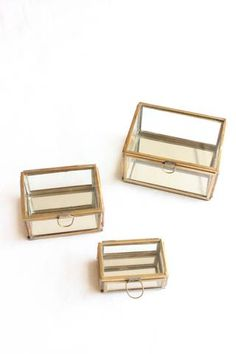 glass and brass boxes