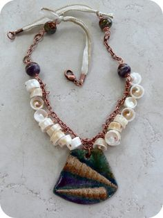 """""""She Sells Sea Shells"""" Necklace by Lori Anderson of Pretty Things using a Clayworksnh Stoneware Atlantic Auger pendant with matching beads, combined with a perfect nautical mix of fiber, shells and copper."""