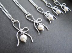 SET of 4 - Matte rodium plated ribbon bow charms with Crystal white Swarovski pearls Bridesmaid Necklaces - Great Gifts for Bridesmaids via Etsy