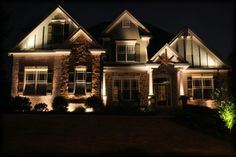 Beautiful architectural lighting display on this craftsman style home by Outdoor Advantage