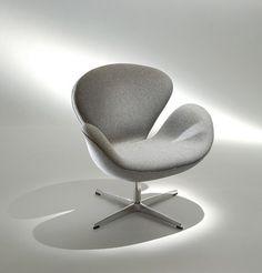 Poltrona Swan Poltrona Swan medida poltrona Swan: 76 x 66 x 78h design Arne Jacobsen descrição Pés em alumínio fundido e polido, concha em poliuretano injetado estofada nas opções: tecido fornecido, couro natural, couro ecológico, veluto e tecido quaker.