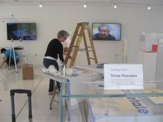 Preparing a new exhibit in the lobby on Marvin Minksy, Muriel Cooper, and Seymour Papert.