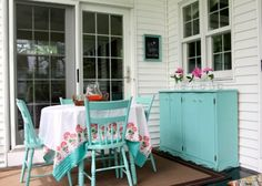 Love this brightly colored painted porch furniture kellyelko.com