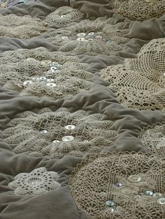 Keepsake doilies and old buttons for making a quilt or using a comforter.  It would be so pretty.....