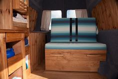 Surf chic... gorgeous woodwork and a rock'n'roll bed with super cool upholstery #vanlife #wales #surfing