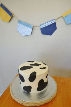 Boy cow print cowboy smash cake. Italian Buttercream and fondant, Top Tier Cakes for All Occasions on Facebook.