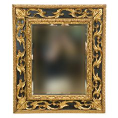 "An Italian mid 19th century painted and partial gilt carved mirror. CIRCA: 1840 DIMENSIONS: 38"" h x 32"" w"