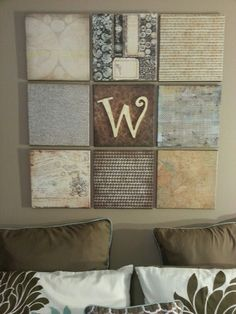 Blank canvases,paint the edges and then modge podge scrapbook paper to them. The center one has a wooden letter glued on it.
