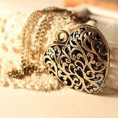 Exquisite Hollow Design Heart Shaped Pendant Alloy Sweater Chain Necklace For Women