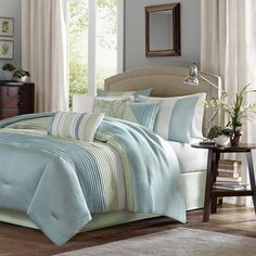 Carter's Resort is a modern color blocked coastal bedding design in an elegant, but simple style to create a fresh look in your beach bedroom retreat! This 7-piece comforter set is covered in larges s