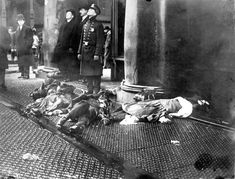 tragic fires in history | Police officer and onlookers with bodies of Triangle fire victims ...