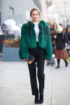 Luxurious fur makes keeps this off-duty model warm after the shows in NYC,