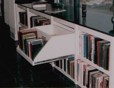 Bookcase pulls out to reveal lateral file drawers in back