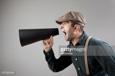 film-director-wearing-flat-hat-and-suspenders-shouting-with-megaphone-picture-id157525434 (507×338)