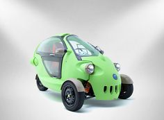 the sam electric car's cartoon-like form, made of fully-recyclable high-density polyethylene, consists of only four panels and is accessed via a folding gull-wing door.