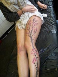 Cherry blossom tree tattoo on whole leg