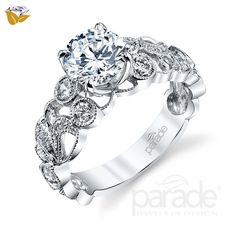 This luxurious white gold ring features the signature Lyria Crown mount and etched milgrain with large diamond accents. Parade Design's from the Hera Bridal collection has twenty-six round cut diamonds for carat total diamond weight. Vintage Inspired Engagement Rings, Best Engagement Rings, Designer Engagement Rings, Fashion Rings, Fashion Jewelry, Women Jewelry, White Gold Rings, Jewelry Design, Wedding Rings