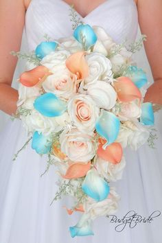 Beach Wedding Photos Davids Bridal Beach Theme cascading Bellini peach and Malibu turquoise wedding bouquet with starfish and seashells Wedding Flowers Turquoise Wedding Bouquets, Beach Wedding Bouquets, Beach Wedding Reception, Beach Wedding Photos, Diy Wedding Bouquet, Beach Wedding Decorations, Beach Wedding Favors, Bride Bouquets, Bridesmaid Bouquet