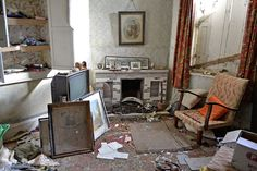 A farm house  filled with forgotten personal effects including letters, photographs, lights and lamps.