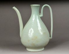 Korean White Glazed Ceramic Ewer Early Cho-son dynasty, possibly 17th century. Missing cap. Height 10 inches.