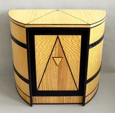 Curved Art Deco Cabinet Made of two types of Satinwood and Wenge. The side detail is created with a sand blaster. The door and the top are inlayed with the Wenge.
