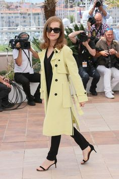 There's a reason why Isabelle Huppert is a front-row fixture at Paris fashion week. The French actress looked radiant in a yellow trench coat at the 2015 Cannes Film Festival.