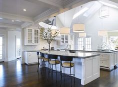 What a gorgeous way to get natural lighting in the kitchen! Digging the balcony overlooking it too... would love to see these house plans!