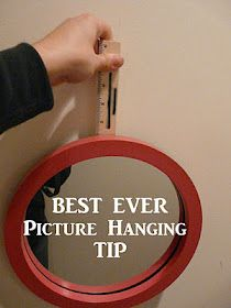 The Best Ever Picture Hanging Tip :: What You'll Need:  A piece of wood and a small nail.  The other blogger used a clothes pin, but I used this little ruler - a promotion item from someone running for election earlier this month.  The wood cannot be so flimsy that it will break when you hold a frame from the nail.