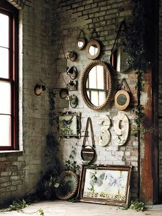 Love the aged bricks and trim... this would make an impressive 'gallery wall'..... with mirrors, empty picture frames, art....your masterpiece is waiting!