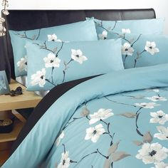This aqua Chi Chi Duvet Cover is an elegant set with an intricate oriental inspired floral design! #bedding